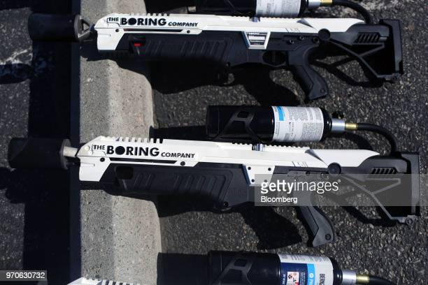 Boring Co. Flamethrowers sit on display during the company's Not-a-Flamethrower Party outside of the Space Exploration Technologies Corp....