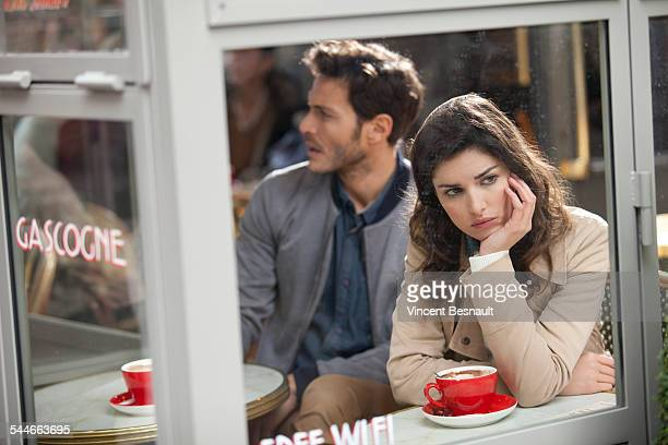 Boring couple in a cafe
