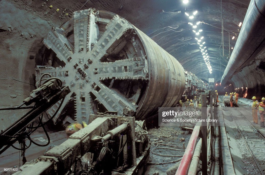 Boring machine, used to carve out rock to construct the Channel Tunnel, by Chris Hogg, 1992. The Channel Tunnel opened in 1995, to create a rail link between London and Brussels and Paris, and connections to many other European cities. The tunnel took 7 years to build and cost £2,700 million.