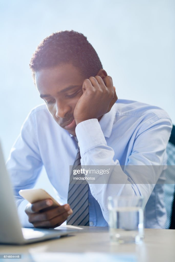 Boring man at meeting : Stock Photo