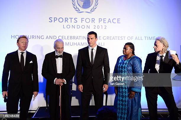 Boris Beck Sir Christopher Lee Wladimir Klitschko Fatou Bensouda and Sir Bob Geldof onstage at the Sports For Peace Fundraising Ball at The VA on...