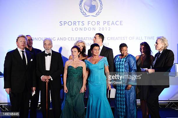 Boris Beck Sir Christopher Lee Wladimir Klitschko Fatou Bensouda Sir Bob Geldof and guests onstage at the Sports For Peace Fundraising Ball at The VA...
