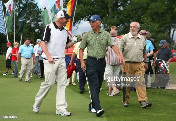 Boris Becker and Franz Beckenbauer walk during the opening of Hartl Golf Resort on June 18 in Penning Germany