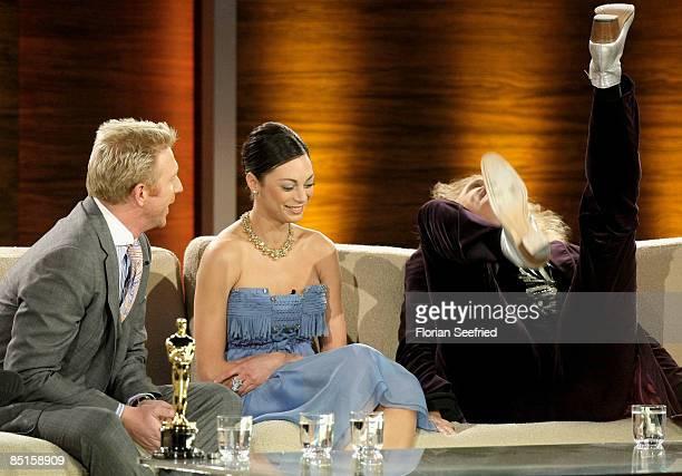 Boris Becker and his partner Lilly Kerssenberg laugh after announcing their engagement next to host Thomas Gottschalk during the Wetten dass...? show...