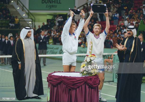 Boris Becker and Patrik Kuhnen of Germany hold the winning trophy after defeating Shelby Cannon and Scott Melville in the Men's Doubles Final of the...