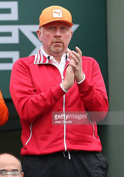 Boris Becker coach of Novak Djokovic applauds during day 3 of the French Open 2015 at Roland Garros stadium on May 26 2015 in Paris France