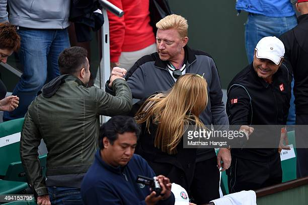 Boris Becker coach of Novak Djokovic of Serbia and Marian Vajda celebrate victory after his men's singles match against Jeremy Chardy of France on...