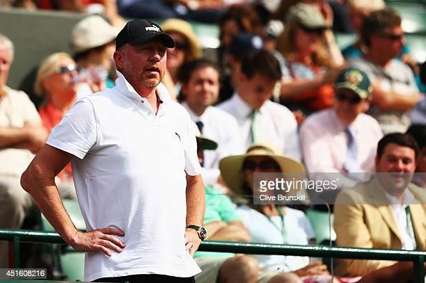 Boris Becker coach of Novak Djokovic of Serbia watches his Gentlemen's Singles quarterfinal match against Marin Cilic of Croatia on day nine of the...