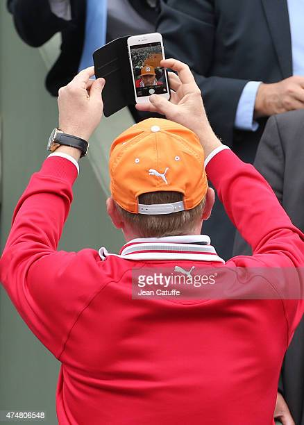 Boris Becker coach of Novak Djokovic takes a selfie with the Center Court in the background during day 3 of the French Open 2015 at Roland Garros...