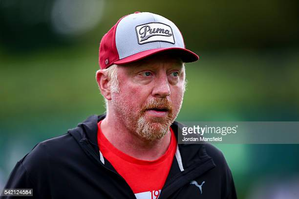 Boris Becker, coach to Novak Djokovic of Serbia watches on during a practice session during day two of The Boodles Tennis Event at Stoke Park on June...