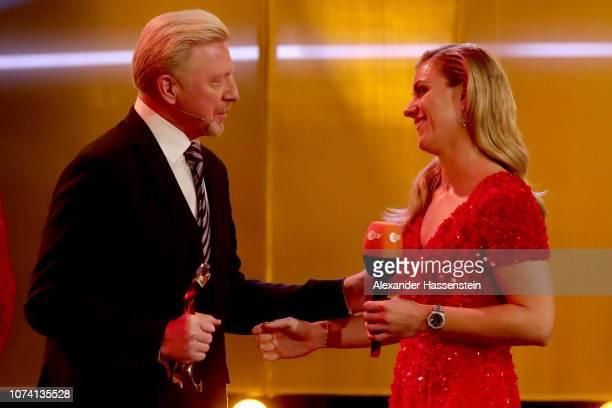 Boris Becker hands-over the female sportsman of the year award to Angelique Kerber during the 'Sportler des Jahres 2018' Gala at Kurhaus Baden-Baden...