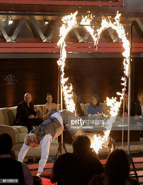 Boris Becker jumps through a burning heart as part of a challenge after announcing his engagement to partner Lilly Kerssenberg during the Wetten dass...