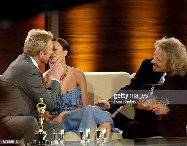 Boris Becker kisses his partner Lilly Kerssenberg after announcing their engagement next to host Thomas Gottschalk during the Wetten dass...? show at...