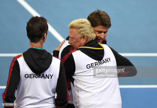 Boris Becker of Germany celebrates with team captain Michael Kohlmann after Alexander Zverev of Germany defeats Alex de Minaur of Australia during...