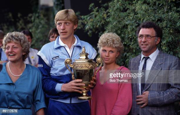 Boris Becker of Germany holding the trophy after winning the Wimbledon Lawn Tennis Championships held at the All England Club in London England...