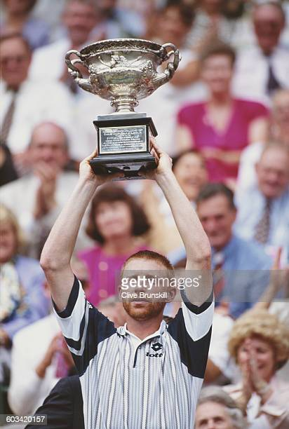 Boris Becker of Germany holds aloft the trophy after the Men's Singles Final of the Australian Open on 28 January 1996 in Flinders Park Melbourne...