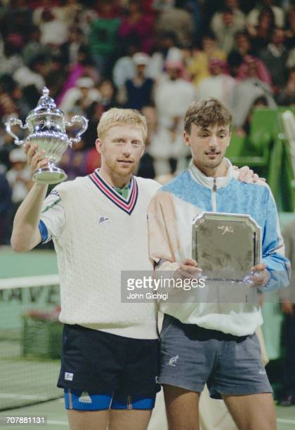 Boris Becker of Germany holds the trophy after defeating Goran Ivanisevic in the Men's Singles Final of the Mannai Cadillac Qatar Tennis Open on 11...