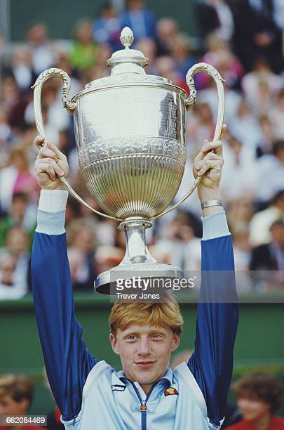 Boris Becker of Germany holds the trophy aloft after winning the Stella Artois Tennis Championship against Johan Kriek on 17 June 1985 at the Queen's...
