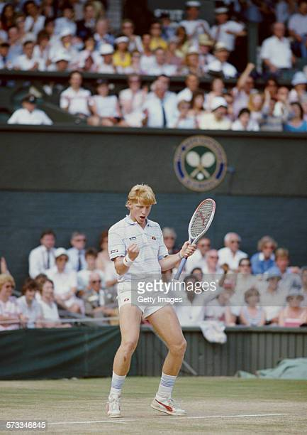 Boris Becker of Germany pumps his arms in the air during his defeat of Kevin Curren in the Men's Singles final of the Wimbledon Lawn Tennis...