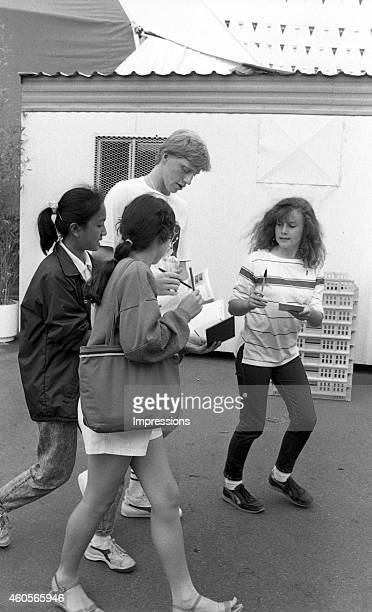 Boris Becker of Germany signs autographs for fans during the 1985 Australian Open Tennis Championship at Kooyong in Melbourne Australia
