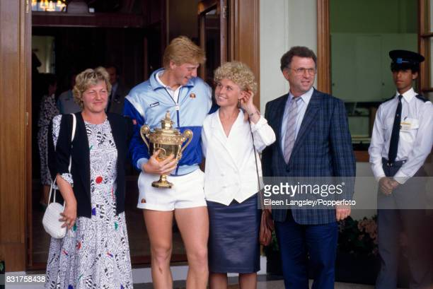 Boris Becker of Germany with the trophy and left to right his mother Elvira sister Sabine and father KarlHeinz following his victory over Ivan Lendl...