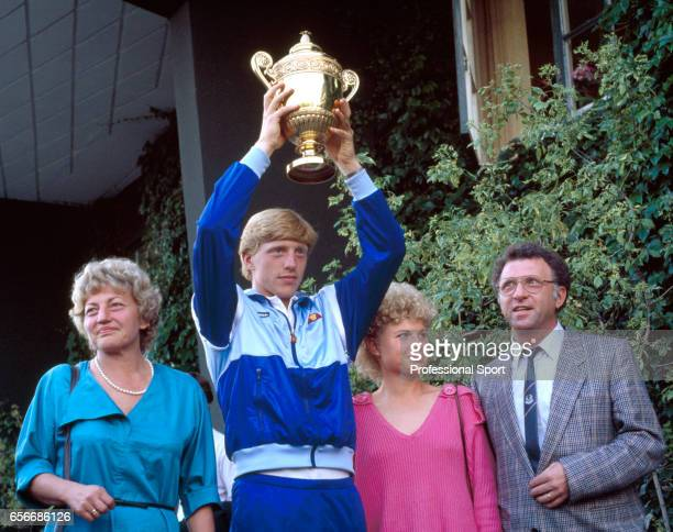 Boris Becker of West Germany holds aloft the trophy surrounded by his family after defeating Kevin Curren of the USA during the men's singles final...