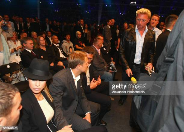 Boris Becker passes his ex fiancee Sandy Meyer-Woelden prior to the WBO, IBF & IBO Heavyweight title fight between Wladimir Klitschko of Ukraine and...