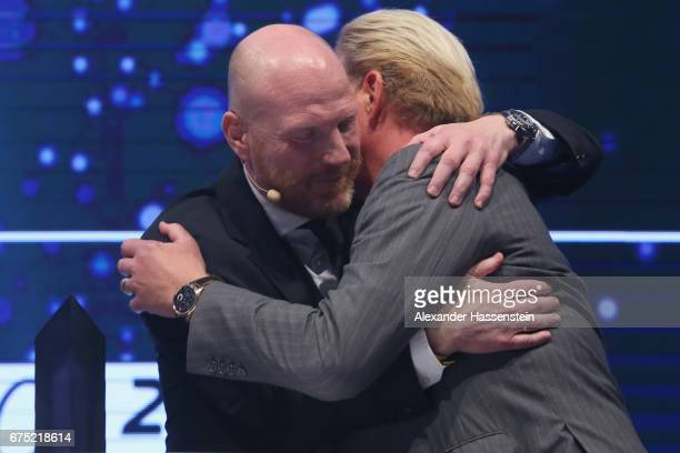 Boris Becker receives the Iphitos Award 2017 from Matthias Sammer at the Players Night of the 102 BMW Open by FWU at Iphitos tennis club on April 30...