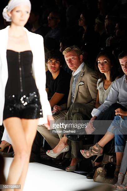 Boris Becker son Noah and Nadine Warmuth sit on front row at the Laurel Show during the Mercedes Benz Fashion Week Spring/Summer 2011 at Bebelplatz...