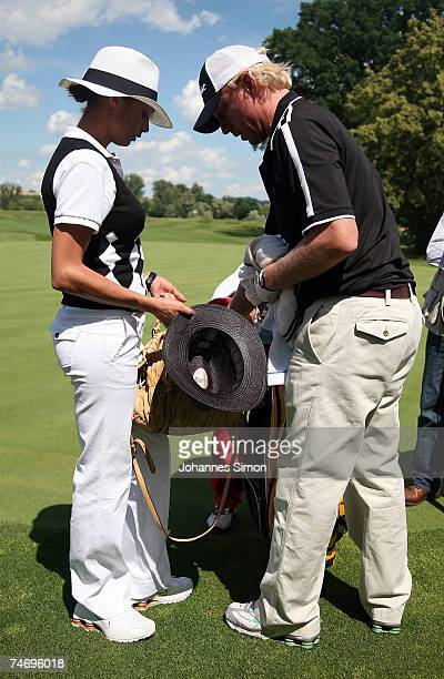 Boris Becker speaks his girlfriend Sharlely Lilly Kerssenberg during the opening of Hartl Golf Resort on June 18 in Penning Germany