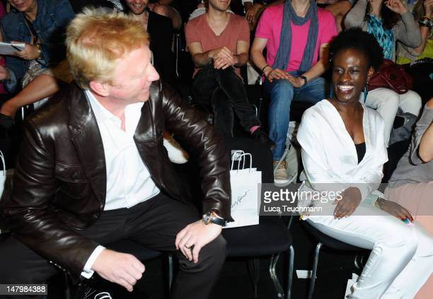 Boris Becker talks to Ivy Quaino prior to the Holy Ghost show at MercedesBenz Fashion Week Spring/Summer 2013 on July 7 2012 in Berlin Germany