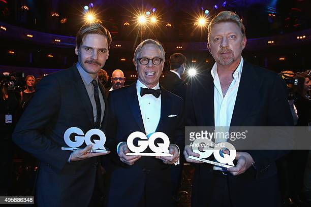 Boris Becker Tommy Hllfiger and Daniel Bruehl are seen on stage at the GQ Men of the year Award 2015 show at Komische Oper on November 5 2015 in...