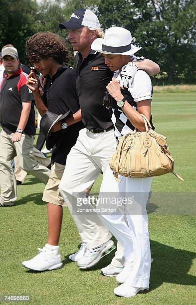 Boris Becker walks across the grounds with his son Noah and his girlfriend Sharlely Lilly Kerssenberg during the opening of Hartl Golf Resort on June...