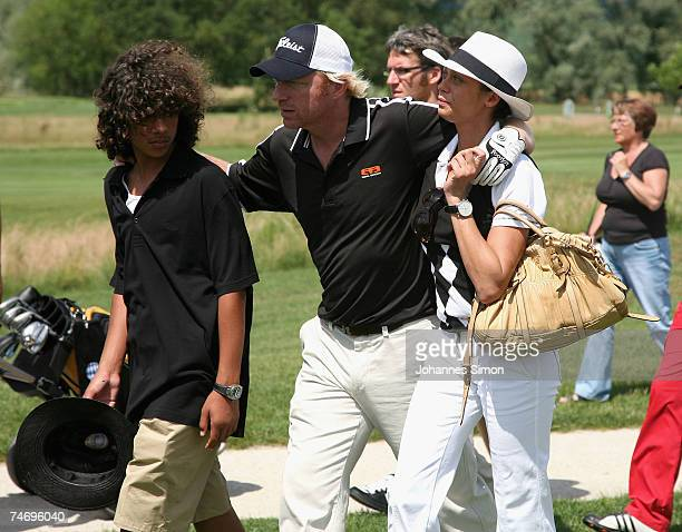 Boris Becker walks across the grounf with his son Noah and his girlfriend Sharlely Lilly Kerssenberg during the opening of Hartl Golf Resort on June...