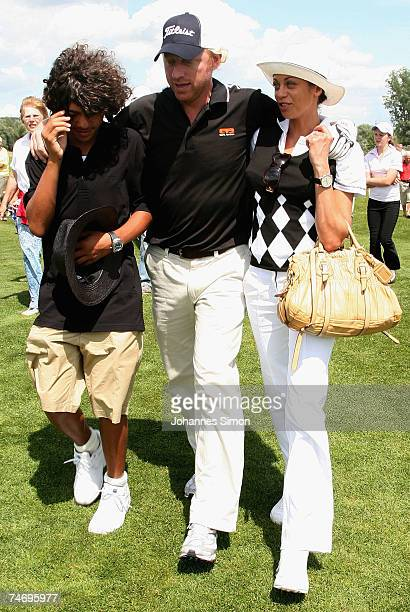 Boris Becker walks over the ground with his son Noah and his girlfriend Sharlely Lilly Kerssenberg during the opening of Hartl Golf Resort on June 18...