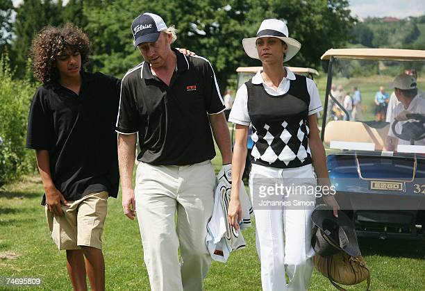 Boris Becker walks with his son Noah and his girlfriend Sharlely Lilly Kerssenberg at the ground during the opening of Hartl Golf Resort on June 18...