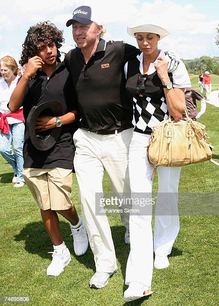 Boris Becker walks with his son Noah and his girlfriend Sharlely Lilly Kerssenberg over the ground during the opening of Hartl Golf Resort on June 18...