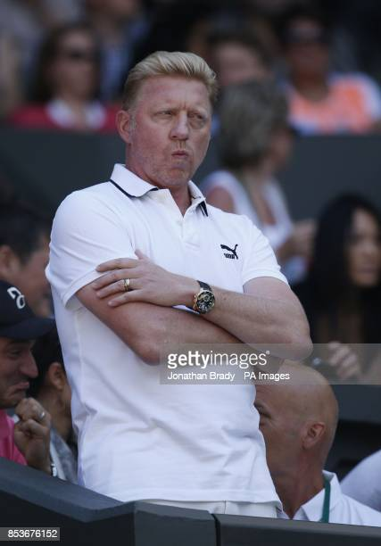 Boris Becker watches Serbia's Novak Djokovic in his Semi Final match against Bulgaria's Grigor Dimitrov on Centre Court during day twelve of the...