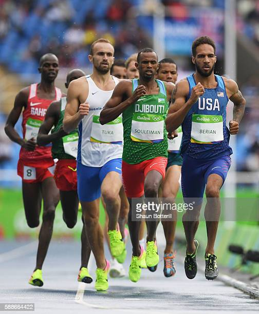 Boris Berian of the United States and Ayanleh Souleiman of Djibouti lead a group in round one of the Men's 800 metres on Day 7 of the Rio 2016...
