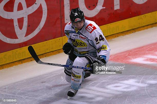 Boris Blank of Krefeld Pinguine celebrates the first goal during the DEL match between Koelner Haie and Krefeld Pinguine at Lanxess Arena on...