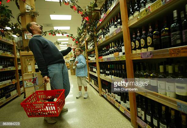 Boris clowns with his daughter Barbara at Trader Joe's as they look at the wracks and wracks of wine for sale in Pasadena on Boris didn't want to...