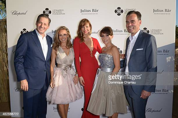 Boris Collardi and Carolina Parsons pose with guests at the Leonardo Dicaprio Gala at Domaine Bertaud Belieu on July 23 2014 in SaintTropez France