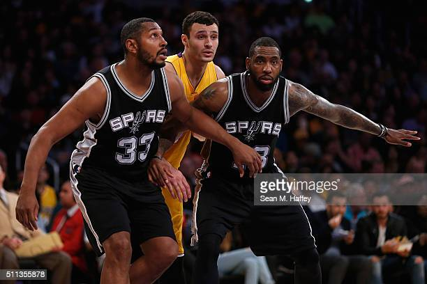 Boris Diaw and Rasual Butler of the San Antonio Spurs block out Larry Nance Jr #7 of the Los Angeles Lakers during the second half of a game at...