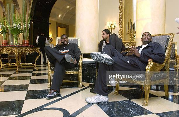 Boris Diaw, Davin White and Kurt Thomas of the Phoenix Suns relax in the lobby of their hotel upon arrival in Cologne, Germany on October 8, 2006 as...