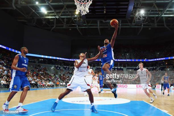 Boris Diaw of France is challenged by Alex King of Germany during the international friendly match between Germany and France at SAP Arena on August...