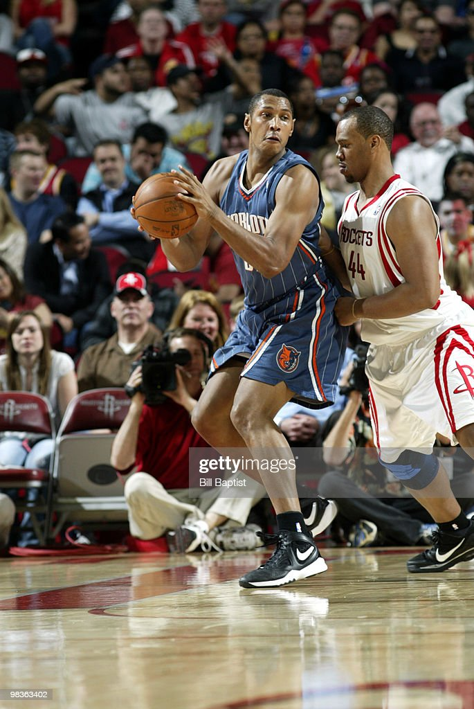 Boris Diaw #32 of the Charlotte Bobcats drives the ball past Chuck Hayes #44 of the Houston Rockets on April 9, 2010 at the Toyota Center in Houston, Texas.