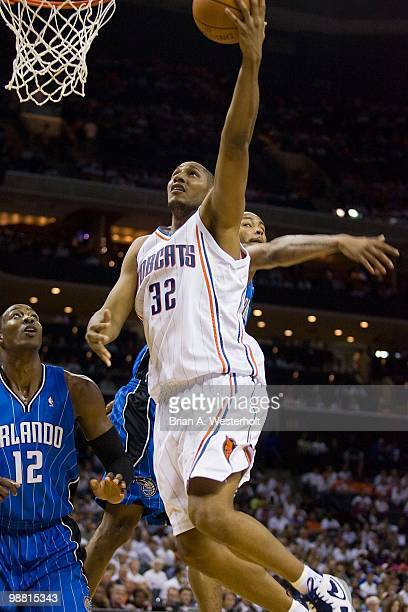 Boris Diaw of the Charlotte Bobcats drives to the basket past Dwight Howard of the Orlando Magic at Time Warner Cable Arena on April 26 2010 in...