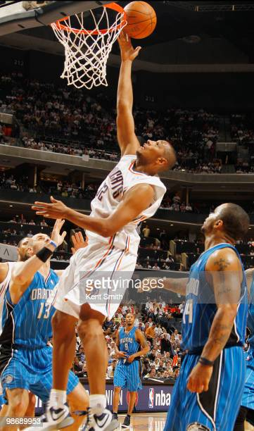 Boris Diaw of the Charlotte Bobcats goes for the layup against Marcin Gortat of the Orlando Magic in Game Four of the Eastern Conference...