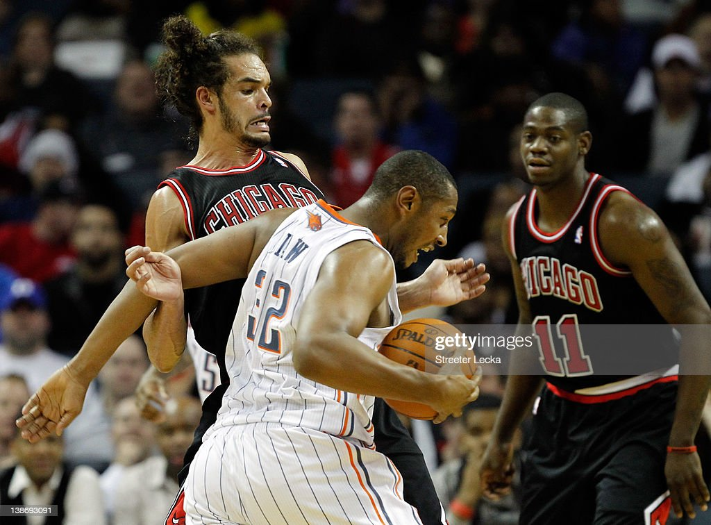 Boris Diaw #32 of the Charlotte Bobcats runs into Joakim Noah #13 of the Chicago Bulls during their game at Time Warner Cable Arena on February 10, 2012 in Charlotte, North Carolina.