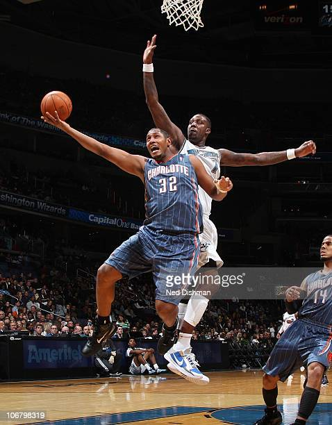 Boris Diaw of the Charlotte Bobcats shoots against Andray Blatche of the Washington Wizards at the Verizon Center on November 12 2010 in Washington...